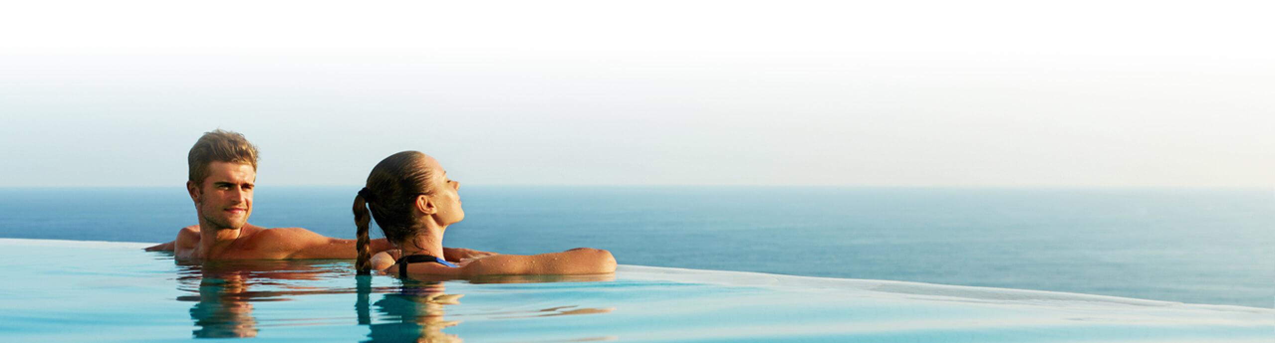 Leisure Travel Couple in Vanishing Pool