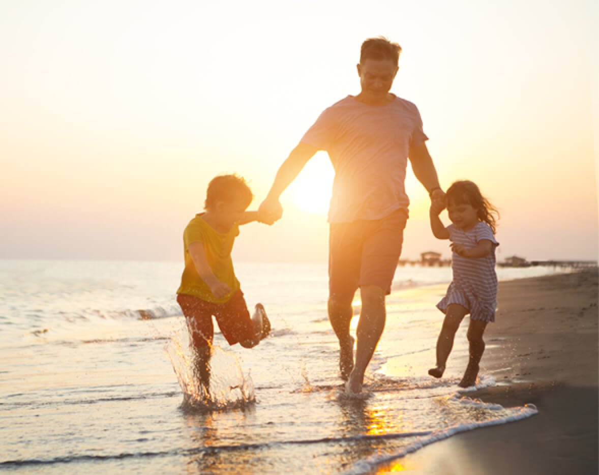 Leisure Travel Dad With Kids on Beach at Sunset